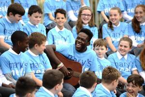 Haitian musician Jimmy Belabre tells Glasgow pupils how charity meals kept him from life of crime